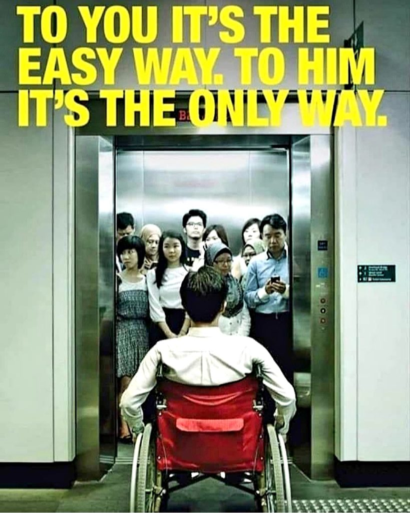 "Image Description: A wheelchair-user is seen facing a lift/elevator full of able-bodied people. Caption reads, ""to you it's the easy way. To him, it's the only way""."