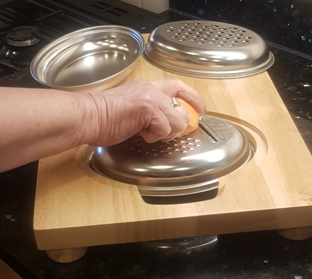 Slicing a sweet potato using the multi-purpose Easi-Grip food prep board